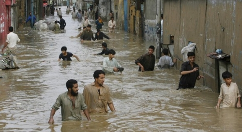 People moving to safety after rain hit karachi