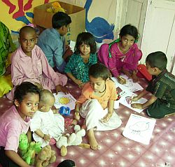 Children studying at cholha ghar.jpg
