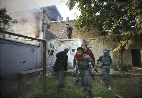 Afghan police officers rescued a wounded German U.N. staffer from a U.N. guest house in Kabul.jpg