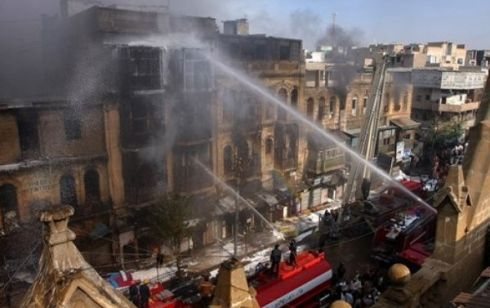 Building burns after Karachi Ashura Blast