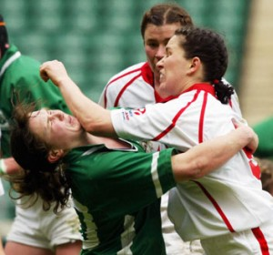 women play rugby