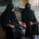 Women with semi automatics in Lyrai Operation Karachi