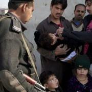 Police adminsters poliovirus vaccine in Pakistan